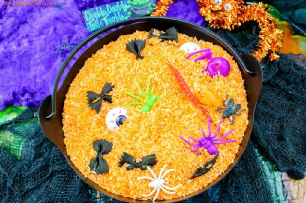Orange witches brew with Halloween toys for kids
