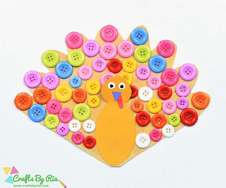 fun craft for kids featuring a turkey papercraft with buttons