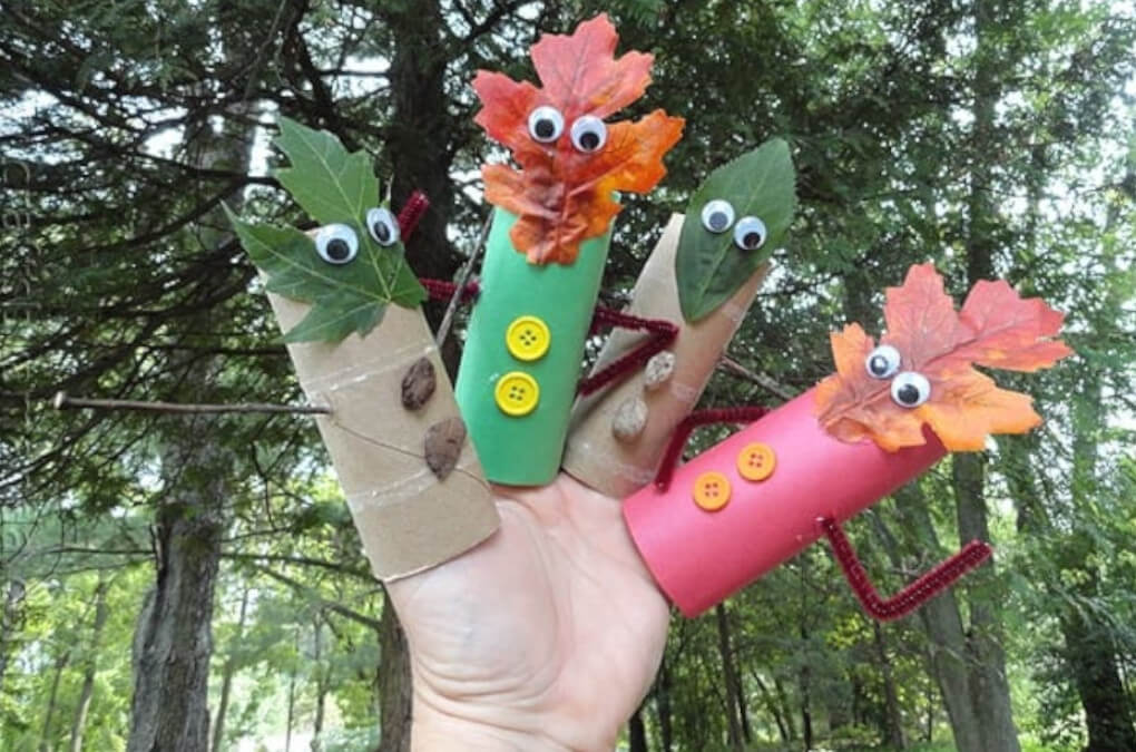 finger puppets autumn themed craft using natural leaves