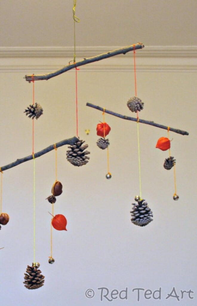 fall-themed mobile DIY craft for kids using pinecones, twigs and acorns