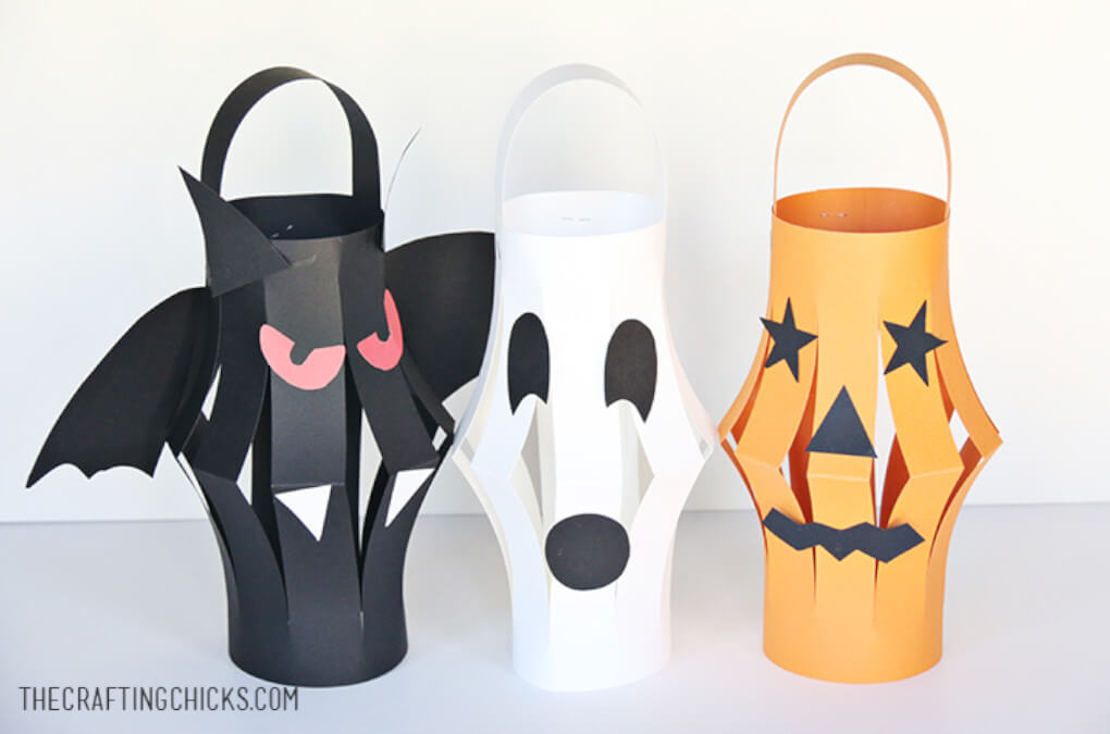 Halloween inspired paper lanterns shaped like a black bat, orange pumpkin and white ghost