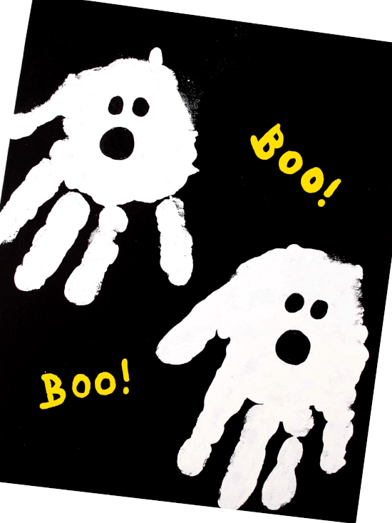 Halloween ghost craft on black paper and white handprint