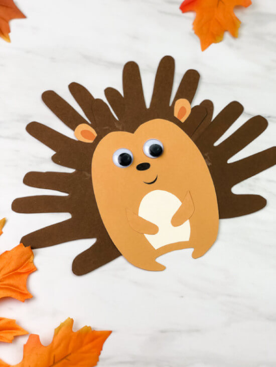 handprint hedgehog in dark and light brown colored paper craft