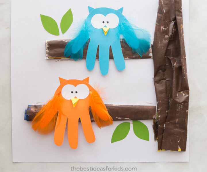 Owl handprint activity craft for kids in orange and blue papercraft