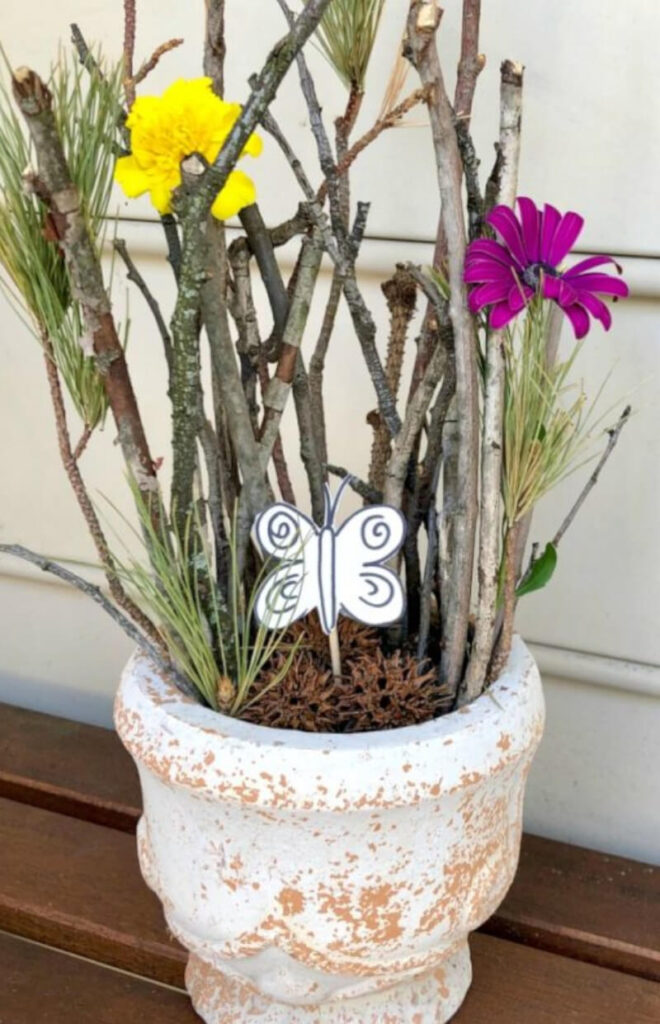 Craft outdoor idea featuring a small world play in nature