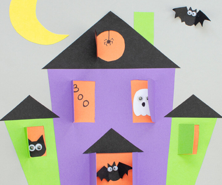 Halloween idea for kids featuring paper haunted house