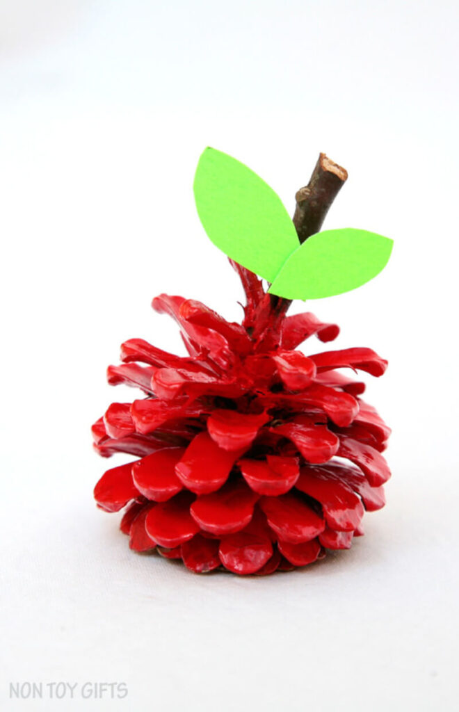 fall-themed project featuring a pinecone apple craft
