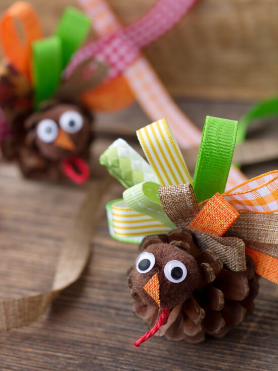 turkey craft made with pine cones and fabric for thanksgiving