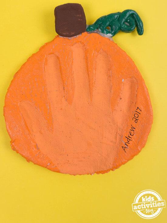 handprint craft for kids featuring pumpkin salt dough