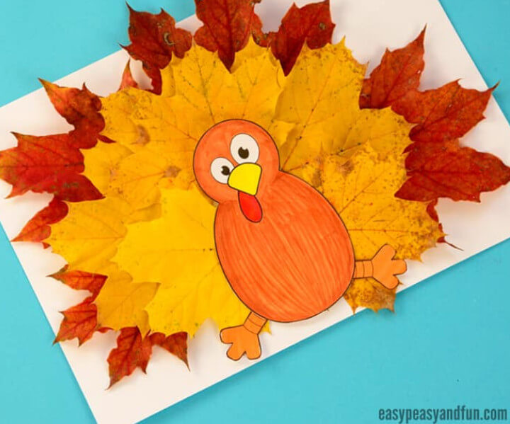 cute fall turkey craft made with orange and red real leaves